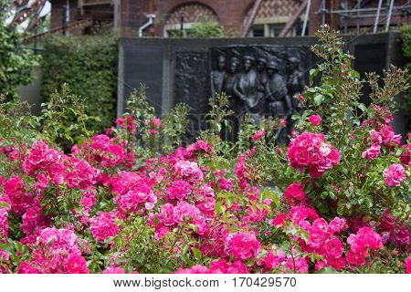 Kate Sheppard memorial and pink camellias in front of in in Christchurch New Zealand