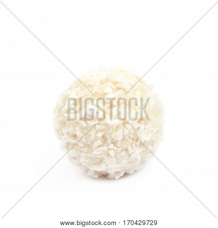 White chocolate ball candy covered with the coconut flakes, composition isolated over the white background