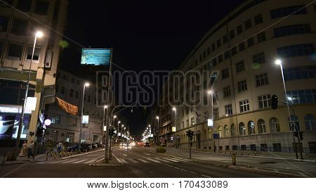 BELGRADE, SERBIA, JULY 2, 2014: Night shot of the road and old buildings at the center of Belgrade, Serbia.
