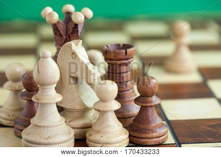 The chess pieces on the chess board