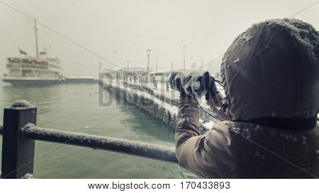 Photographer Trying To Shoot Under Heavy Snow, Istanbul, Turkey