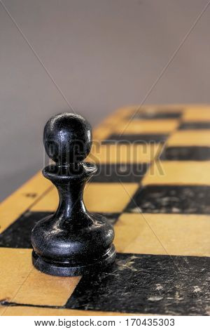 The black chees pawn on the chessboard