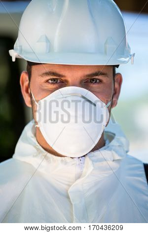 Close-up of pest control man wearing protective workwear