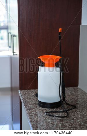 Insecticide sprayer on kitchen worktop at home