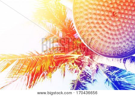 Close up  shower head under plam tree on tropical beach