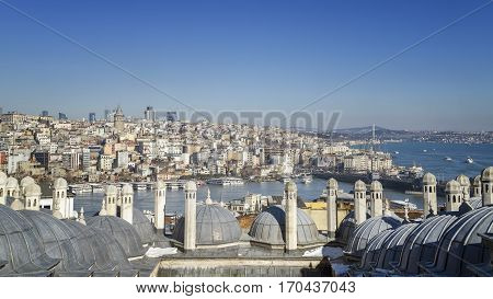 ISTANBUL, TURKEY, JANUARY 13, 2017: Panoramic view of Halic (Golden Horn) and Galata Bridge from the terrace of Suleymaniye Mosque.