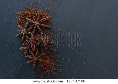 Whole and Ground Star Anise on Slate with copy space to right