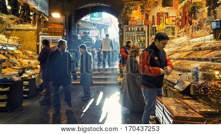 ISTANBUL, TURKEY, JANUARY 13, 2017: People walking and shopping inside the Spice Bazaar (Misir Carsisi) one of the largest bazaars in the city. Located in the Eminonu quarter of the Fatih district.