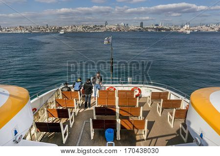 ISTANBUL, TURKEY, JANUARY 31, 2017: People travelling across Bosphorus on the upper deck of newly designed Sehir Hatlari Ferry, Istanbul, Turkey.
