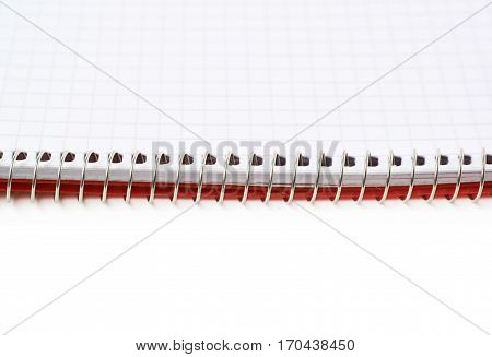 Opened squared paper notebook isolated over the white background, close-up crop fragment