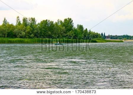 Boat with fishermen at the river Dnieper, Ukraine