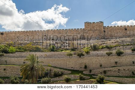 View of the Golden Gate or Gate of Mercy and olive garden on the east-side of the Temple Mount of the Old City of Jerusalem Israel