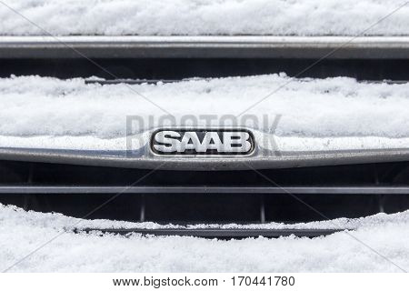 The Hague the Netherlands - February 11 2017: Saab emblem covered in snow emblem