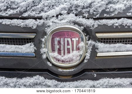 The Hague the Netherlands - February 11 2017: Fiat emblem covered in snow