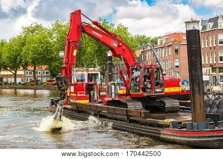 Excavator In Historical Part Of Amsterdam