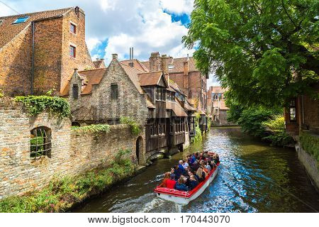 Tourist Boat On Canal In Bruges
