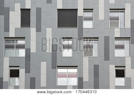 Grey geometrical facade. Squares conforming an abstract architecture background.