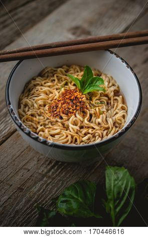 Instant Noodles in White bowl on Old Wooden Easy Cook used for food ad or website promote. Food for people to work in the rush hour