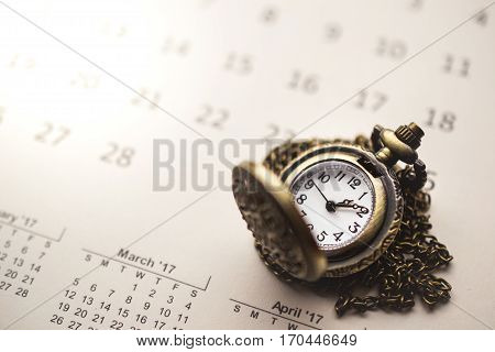 Time for Waiting with Vintage Pocket Watch on the Calendar and space for copyImage for Deadline Time Concept used for food ad or website promote.