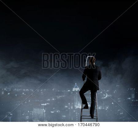 Businessman standing on stepladder over night city background.  Business, career, concept.