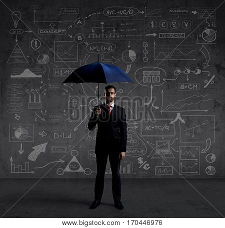 Businessman with umbrella standing over schematic background. Business and office, concept.
