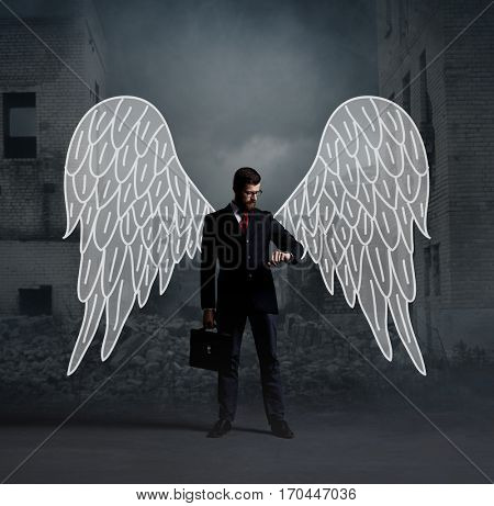 Business angel standing over apocalyptic background. Crisis, default, setback concept.