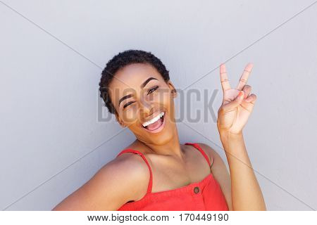 Beautiful Young Black Woman Smiling With Peace Hand Sign