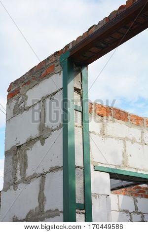 Window steel lintel on brick house construction.