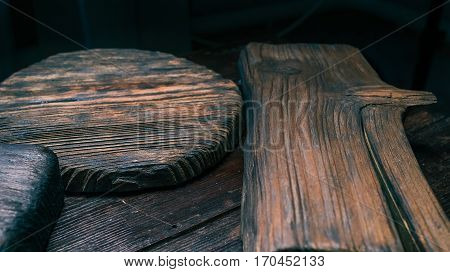Various textured old dark brown wood serving boards. Cooking or serving background. Close-up view