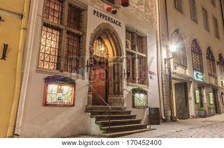 Tallinn, Estonia - November 21, 2016: Vanaturu Street In Historical Centre Of Old Town In Evening Illumination. Traditional Medieval Houses On Old Narrow Street. Tallinn, Estonia.