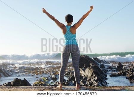 Behind Of African American Sports Woman With Arms In The Air