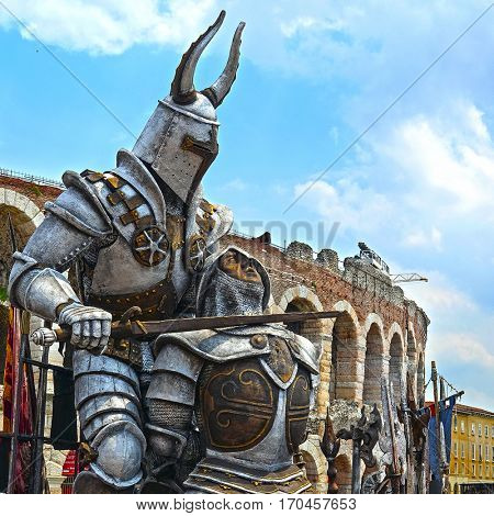 VERONA, ITALY - JULY, 2, 2016: sculpture of Gladiator infront of Arena of Verona(in Italian it is called Arena di Verona),ancient amphitheatre used today as a stage for concerts and Opera performances