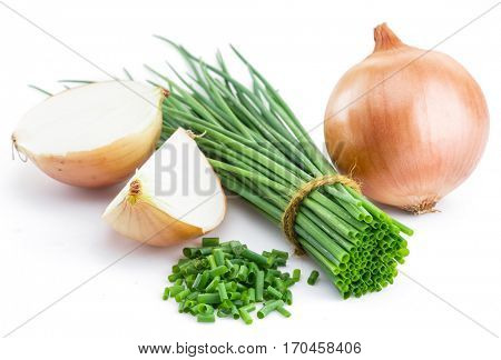 Green onions and bulb onion isolated on the white background.