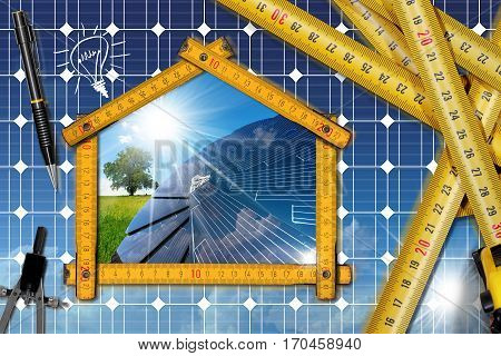 Wooden ruler on a desk in the shape of ecologic house with a solar panel and sun rays. Concept of ecological house design