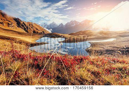 Sunset on mountain lake Koruldi. Upper Svaneti Georgia Europe. Caucasus mountains.