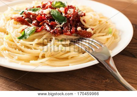 Italian dish - pasta with sundried tomato and basil.