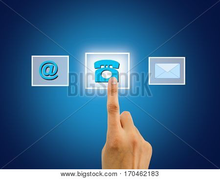 Contact us concept using female hand touching a button