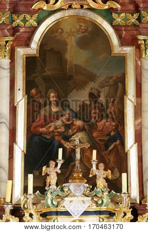 KRASIC, CROATIA - MAY 15: Nativity Scene, Adoration of the Magi altarpiece in parish church of the Holy Trinity in Krasic, Croatia on May 15, 2012