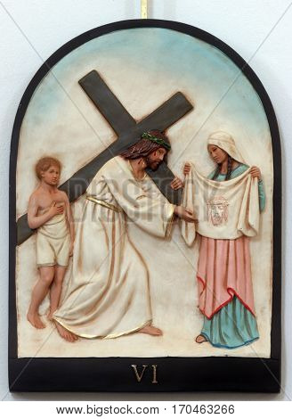 HRVATSKA DUBICA, CROATIA - NOVEMBER 18: 6th Stations of the Cross, Veronica wipes the face of Jesus, Parish Church of Holy Trinity in Hrvatska Dubica, Croatia on November 18, 2010.