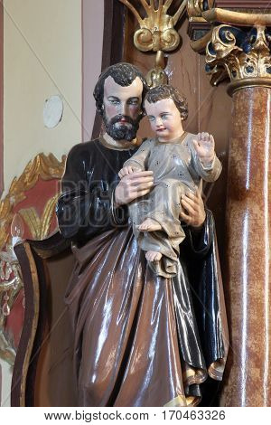 MARTINSKA VES, CROATIA - JUNE 03: Saint Joseph holding baby Jesus statue on the altar in Parish Church of Saint Martin in Martinska Ves, Croatia on June 03, 2011.