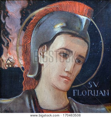 KRASIC, CROATIA - JUNE 11: Saint Florian, Parish church of the Holy Trinity in Krasic, Croatia on June 11, 2016
