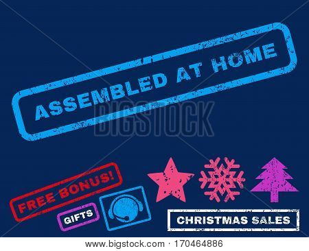 Assembled At Home text rubber seal stamp watermark with bonus new year symbols. Tag inside rectangular shape with grunge design and scratched texture.