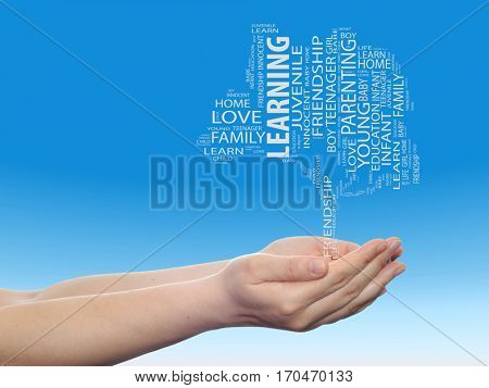 Concept conceptual black education text word cloud or tagcloud as a tree on man or woman hand on blue sky  background metaphor to child, family, education, life, home love and school learn achievement