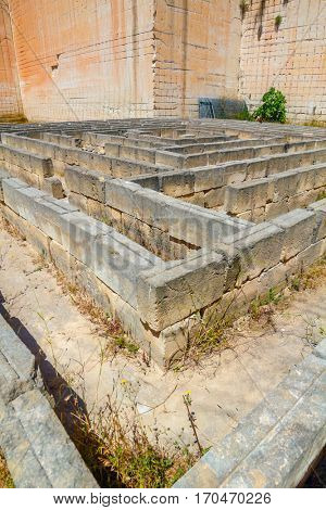 Tiny maze made of stone blocks in old abandoned stone quarries Lithica Pedreres des Hostal, Menorca island, Spain.