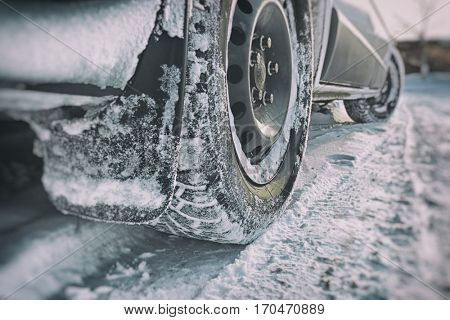 Car's tire covered by snow