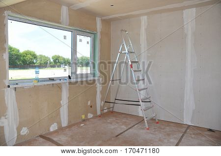 Construction building industry new home construction interior drywall tape. Building construction gypsum plaster walls
