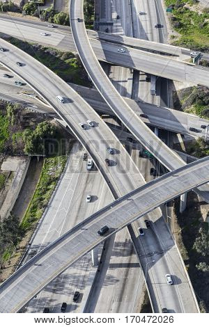 Aerial of the Golden State 5 and Route 118 freeway interchange in the San Fernando Valley area of Los Angeles California.