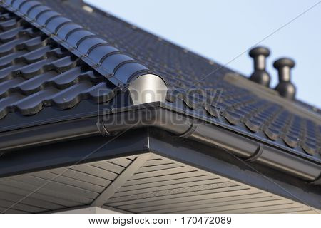 Corner of the house with gutter.