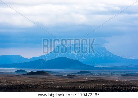 Typical Iceland landscape with lavas field and volcano, Iceland, Europe.