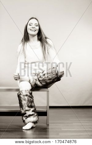 Woman Sitting On Bench Wearing Furry Shoes